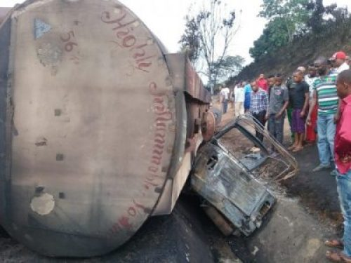 FEAR GRIPS RESIDENTS AS PETROL TANKER SOMERSAULTS