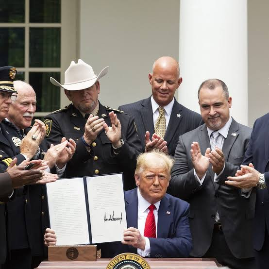 TRUMP SIGNS NEW POLICE REFORM THAT'LL BAN CHOKE HOLDS UNLESS AN OFFICER'S LIFE IS IN DANGER AFTER WEEKS OF PROTESTS ABOUT RACIAL INJUSTICE