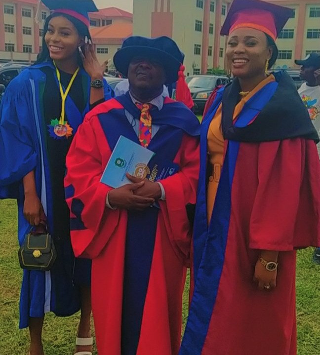 Man and his two daughters have their convocation