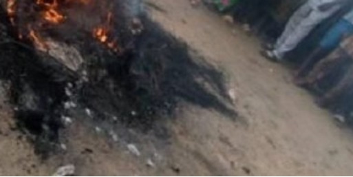 PRISON INMATE WHO ESCAPED DURING THE JAILBREAK IN IMO IS SET ABLAZE AFTER GOING BACK TO THREATEN A FAMILY THAT TESTIFIED AGAINST HIM IN COURT.PHOTOS