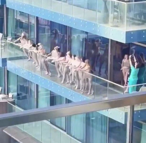 WOMEN ARRESTED AFTER STRIPPING TO POSE NAKED FOR 'STUNT' IN DUBAI.PHOTOS