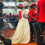 WOMAN STORMS ABUJA CHURCH WEARING A WEDDING DRESS TO EXPRESS HER FAITH IN GOD FOR HER MARITAL BREAKTHROUGH (PHOTOS)